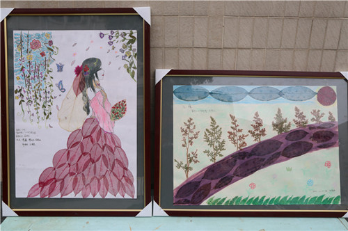 湖北秭归二中学生用落地树叶绣出优美风景画